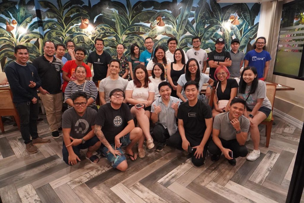 A photograph of a large group of Phillipine WordPress community leaders posing and smiling for the camera as they attend, organize, and speak at the first ever WordCamp Davao.